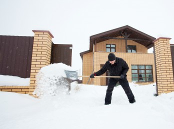 Man cleans snow shoveling